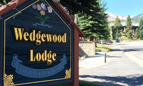The Wedgewood Lodge sign welcomes guests at they arrive at our Breckenridge CO hotel.
